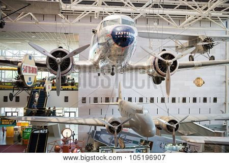 WASHINGTON, USA - AUG 26, 2014: Silver airplane is hanging under the ceiling at National Air and Space Museum.