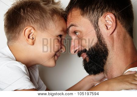Portrait of a bearded man and young cute boy