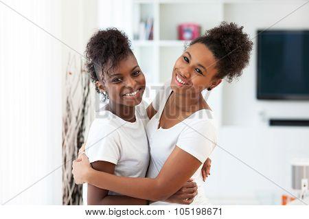 African American Teeange Best Friends Portrait Hugging - Black People