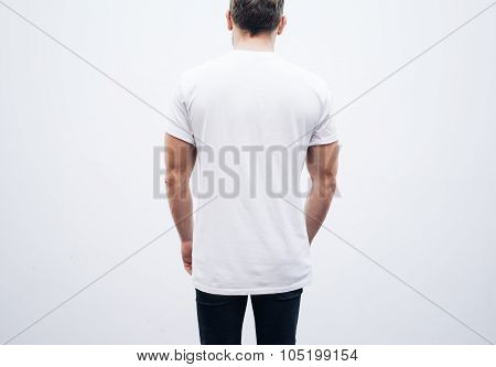Man wearing blank tshirt and blue jeans on the white background.