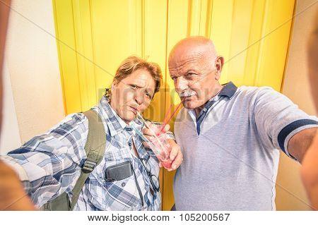 Senior Happy Couple Taking A Selfie While Eating A Granita Crushed Ice Cream - Youthful Elderly