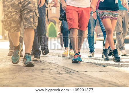 Crowd Of People Walking On The Street - Detail Of Legs And Shoes Moving On Sidewalk In City Center