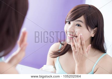 Smile Woman Applying Moisturizer Cream