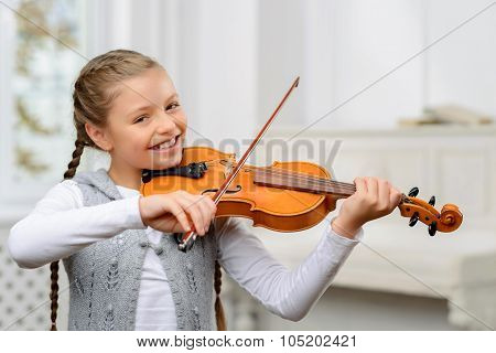 Nice girl playing the violin