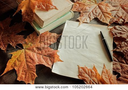 Vintage Still Life - Old Books With Yellowed Sheet And Old Ink Pen Near Dry Maple Leaves