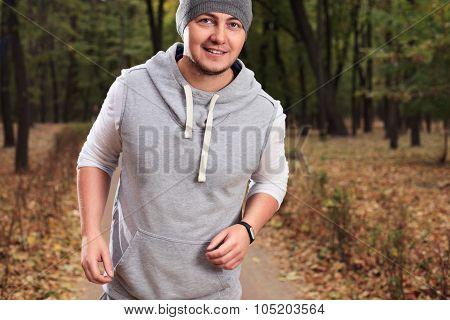 Jogging Young Man At The Park