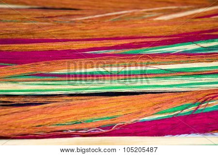 Soft orange pink green cotton thread for abstract background