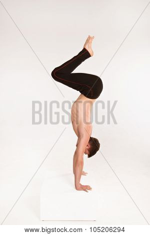 Slender Man Doing Gymnastic Exercises. Gymnast Standing On Hands