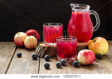 Compote Of Apples And Blackthorn In A Jug And Glasses