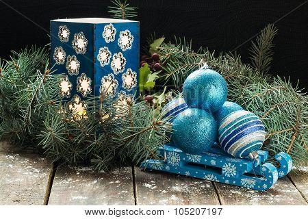 Christmas Composition Of Christmas Balls On A Sled, And Candlestick