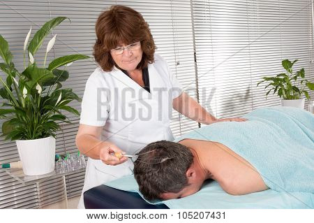 Man Is Getting A Very Relaxing Massage At Spa Center