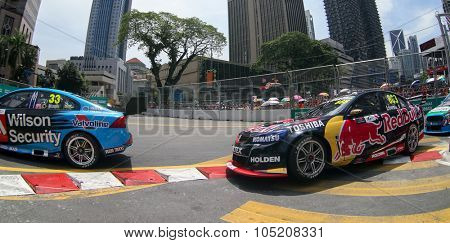 KUALA LUMPUR, MALAYSIA - AUG 09, 2015: Scott McLaughlin leads Craig Lowndes as they race in the streets of Kuala Lumpur in the V8 Supercars Street Challenge at the 2015 Kuala Lumpur City Grand Prix.