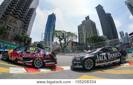 KUALA LUMPUR, MALAYSIA - AUGUST 09, 2015: Craig Lowndes leads Todd Kelly as they race in the streets of Kuala Lumpur in the V8 Supercars Street Challenge at the 2015 Kuala Lumpur City Grand Prix.