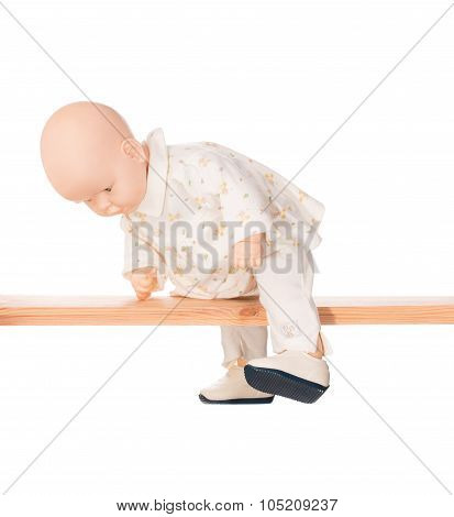 Baby doll on a crossbar