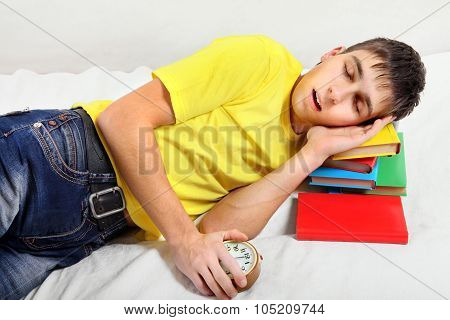 Tired Teenager Sleep On The Books