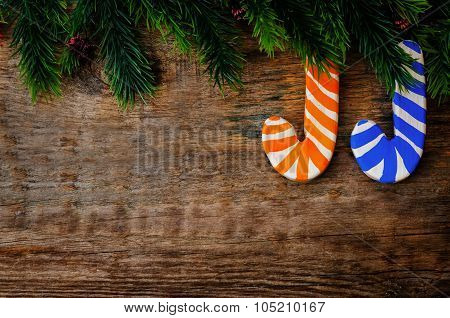 Wooden Background With Wooden Christmas Shaped Stick And The Branches Of The Christmas Tree