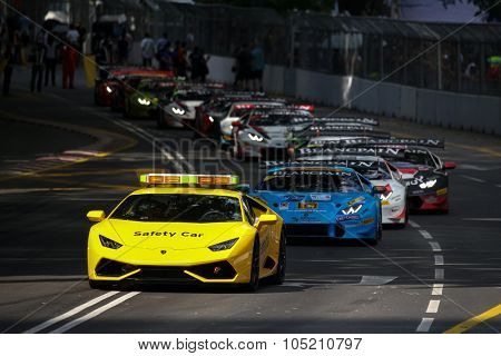 KUALA LUMPUR, MALAYSIA - AUGUST 09, 2015: The yellow safety car starts the Lamborghini Blancpain Super Trofeo Race at the 2015 Kuala Lumpur City Grand Prix.