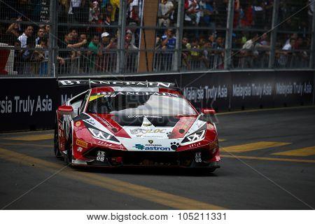KUALA LUMPUR, MALAYSIA - AUGUST 09, 2015: Kazuki Hiramine in a Lamborghini Super Trofeo LP620 car races in the Lamborghini Blancpain Super Trofeo Race at the 2015 Kuala Lumpur City Grand Prix.