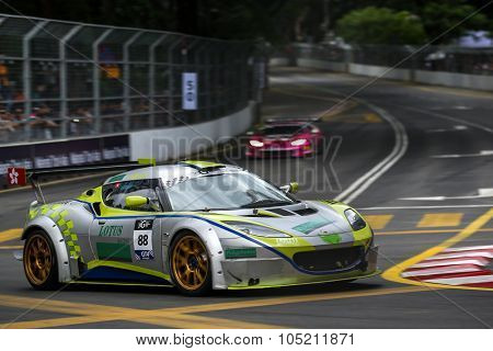 KUALA LUMPUR, MALAYSIA - AUGUST 09, 2015: Anthony Chan in a Lotus Evora GT4 car races city street circuit in the KL City GT Cup Race at the 2015 Kuala Lumpur City Grand Prix.