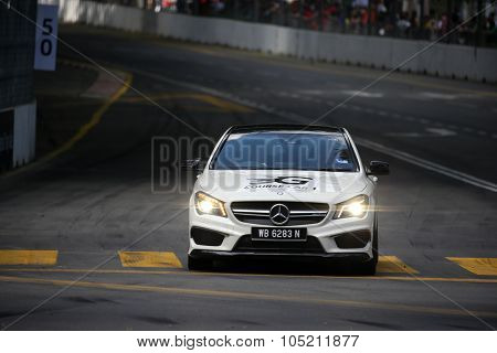 KUALA LUMPUR, MALAYSIA - AUGUST 09, 2015: A Mercedes Benz safety car inspects the race tracks before in the Formula Masters China Series Race at the 2015 Kuala Lumpur City Grand Prix.