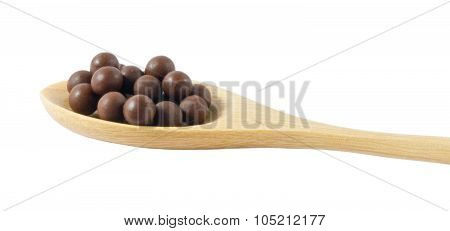 Wooden Spoon Full Of Herbal Cough Lozenges Isolated On White