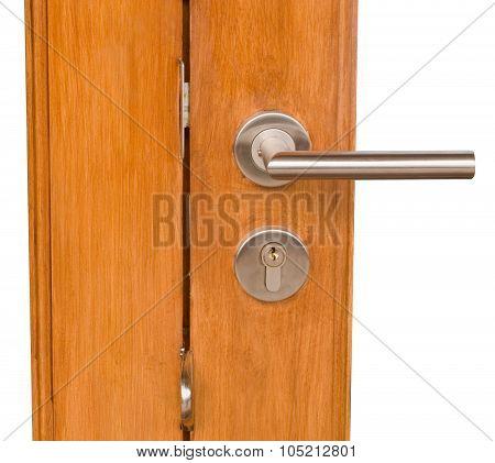 Lock And Door Handle On Golden Brown Wooden Door