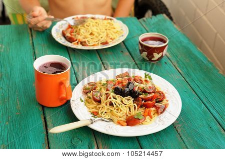 Spaghetti Al Pomodoro In White Plates With Fork On Wooden Turquoise Table
