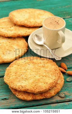 Fresh Homemade Coffee Espresso With Froth, Silver Spoon, Almond Cookies And Whole Almonds