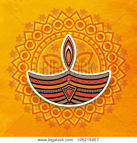 Beautiful illuminated lit lamp on floral design decorated yellow background for Indian Festival of Lights, Happy Diwali celebration.