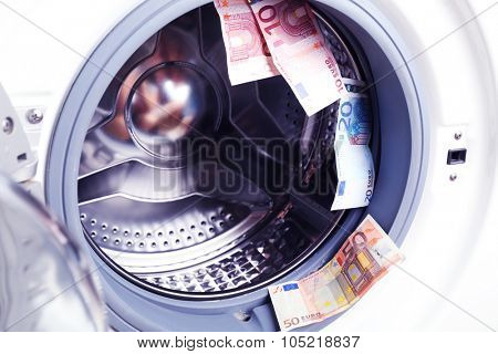 Money in washing machine, close up