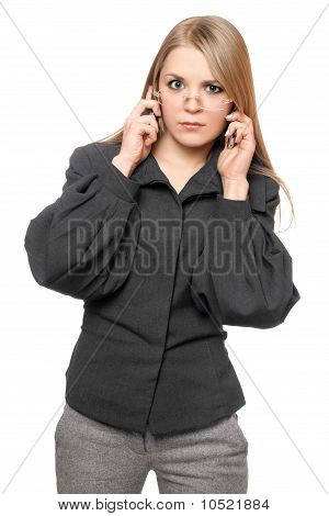 Portrait Of Discontented Young Blonde In A Gray Business Suit