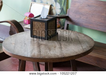 Basket Weave Tissue Box On Wood Table In Public Cafe With Natural Light