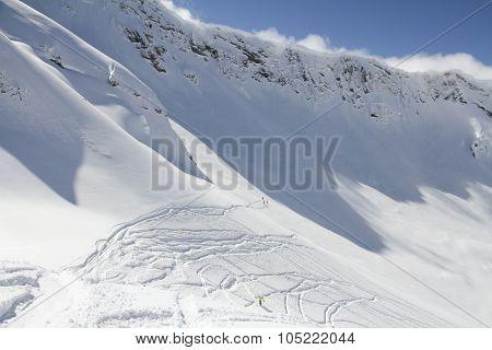 Extreme Freeride, tracks on a mountain slope.
