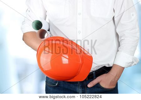 Engineer Holding Orange Helmet For Workers Security
