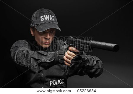 SWAT police officer with pistol
