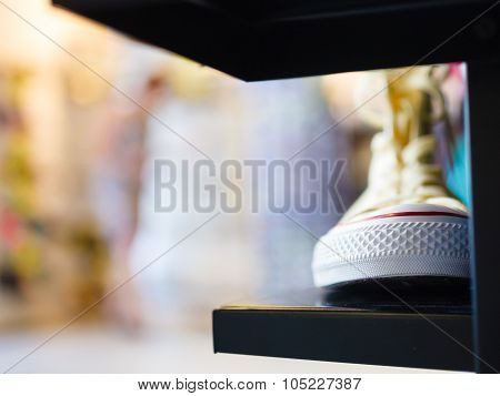 Closeup Fashionable Sneakers On Shop Shelf