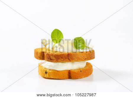 bread rusks with cream cheese on white background
