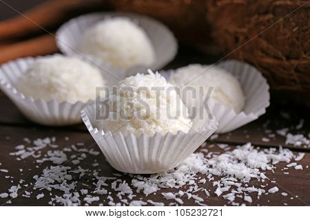Coco sweets on dark wooden background