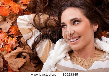 Happy Girl  Lying On Autumn Leaves