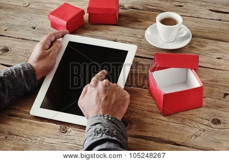 Man Orders Christmas Gifts Using A Tablet Computer