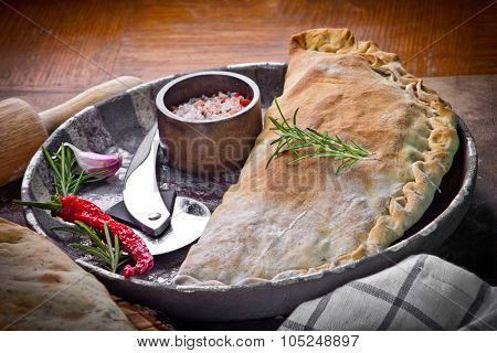 Calzone, closed pizza, Italian pastry stuffed with cheese, meat