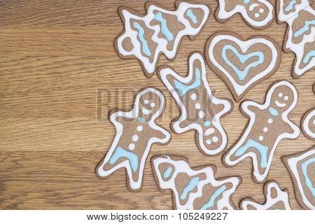Variety of gingerbread cookies fresh on a wooden table