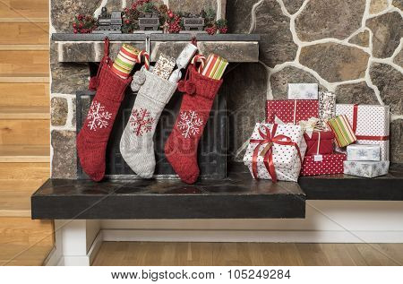 Stuffed stockings hanging on a fireplace on christmas morning