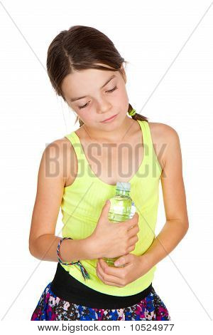 Thoughtful Girl Holding Bottle Of Mineral Water