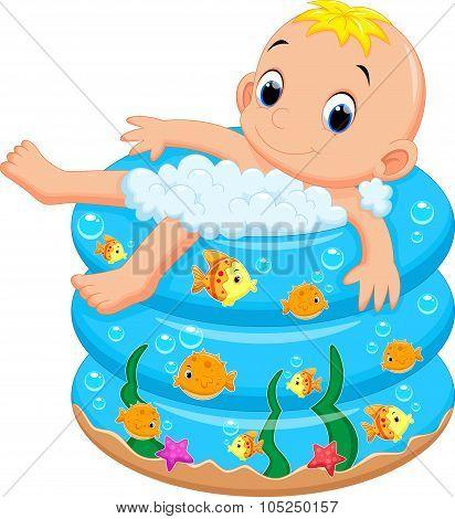 Baby boy bath in a bathtub with lot of soap