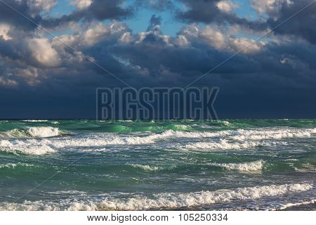 a ocean waves and stormy sky