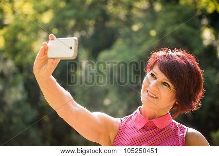Senior woman outdoor selfie