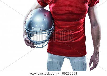American football player holding helmet aside against white background