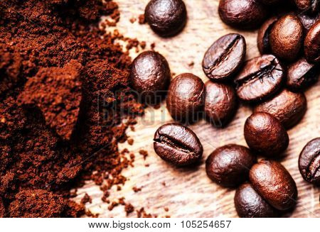 Coffee Beans On Macro Ground Coffee Background, Top View Image. Arabic Roasting Coffee - Ingredient