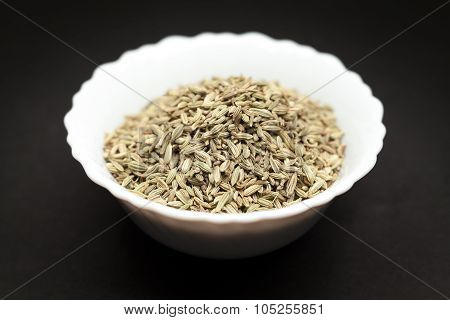 Organic Fennel seed in white bowl.